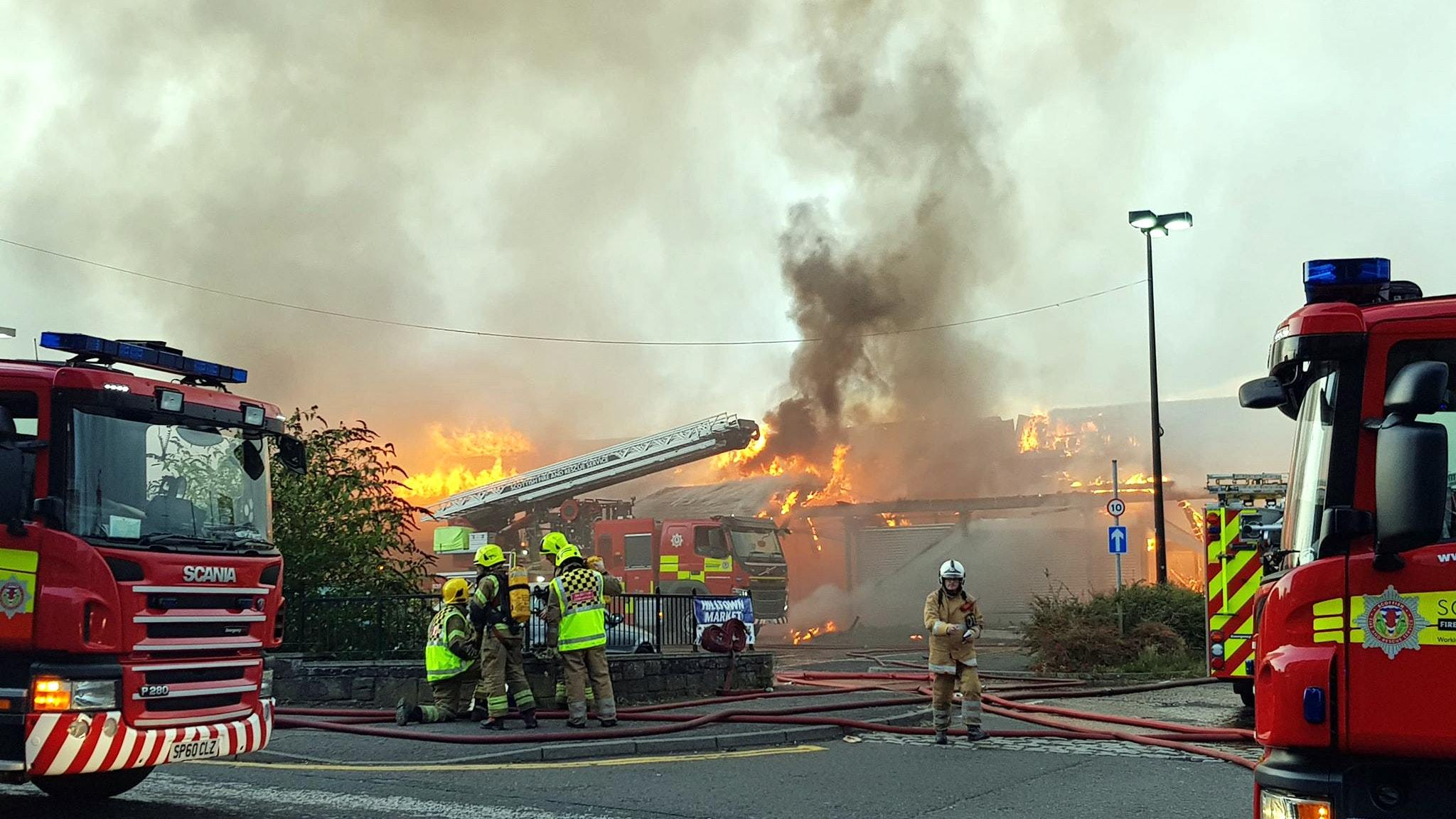Firefighters attend the scene (PA)