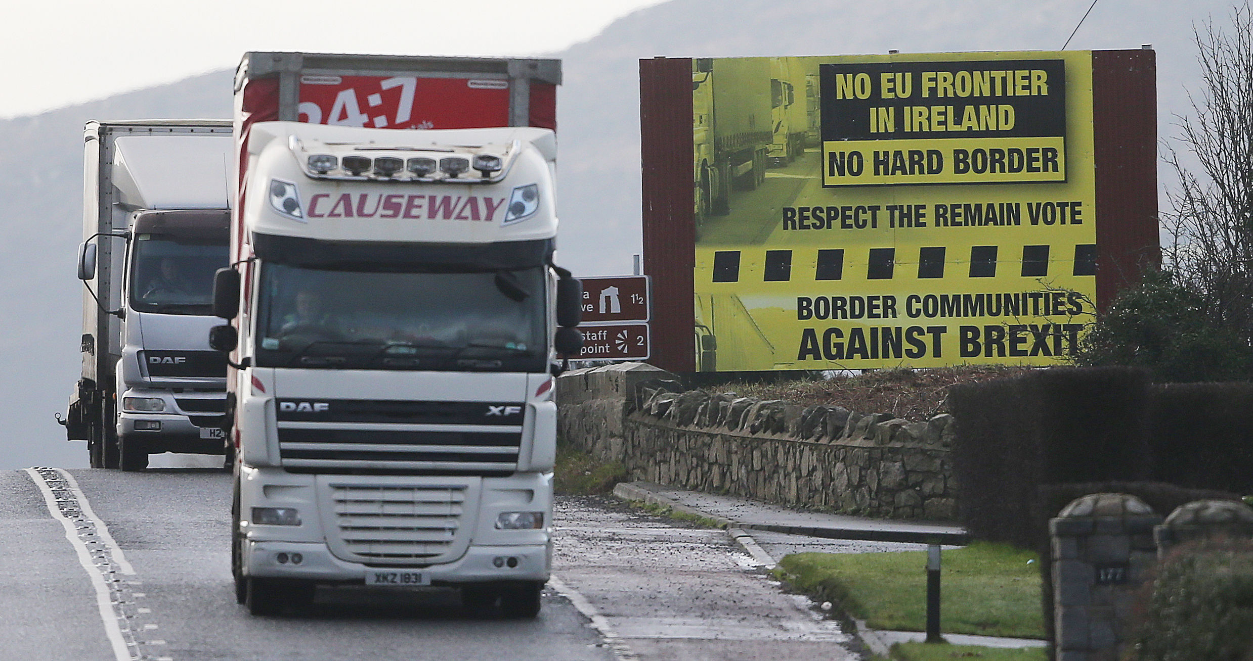 A truck passes a Brexit billboard in Jonesborough, Co. Armagh, on the northern side of the border between Northern Ireland and the Republic of Ireland, (Niall Carson/PA Wire)
