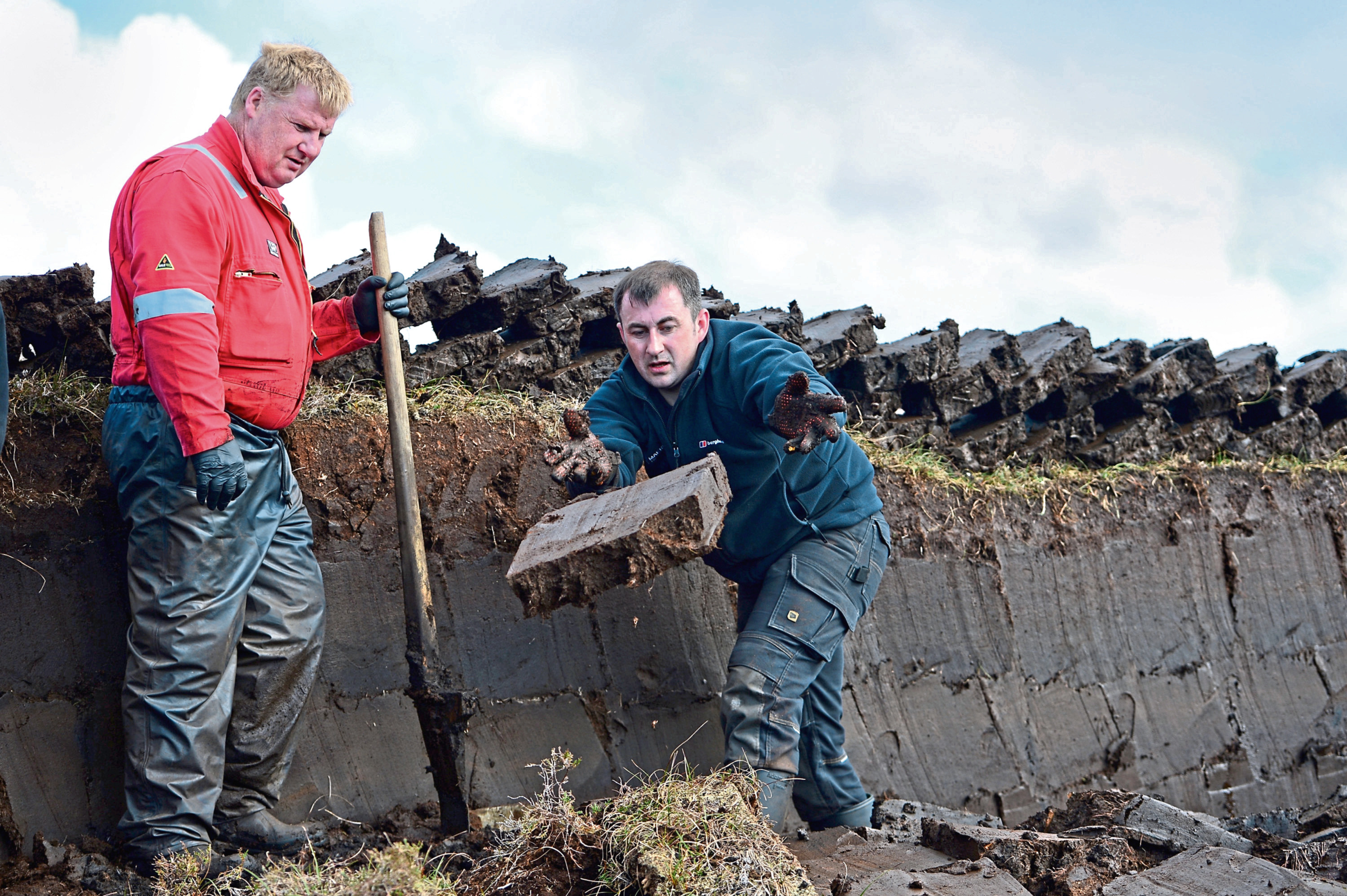 Angus Smith and Callum Mckenzie cutting peat on Isle of Lewis (Jeff J Mitchell/Getty Images)