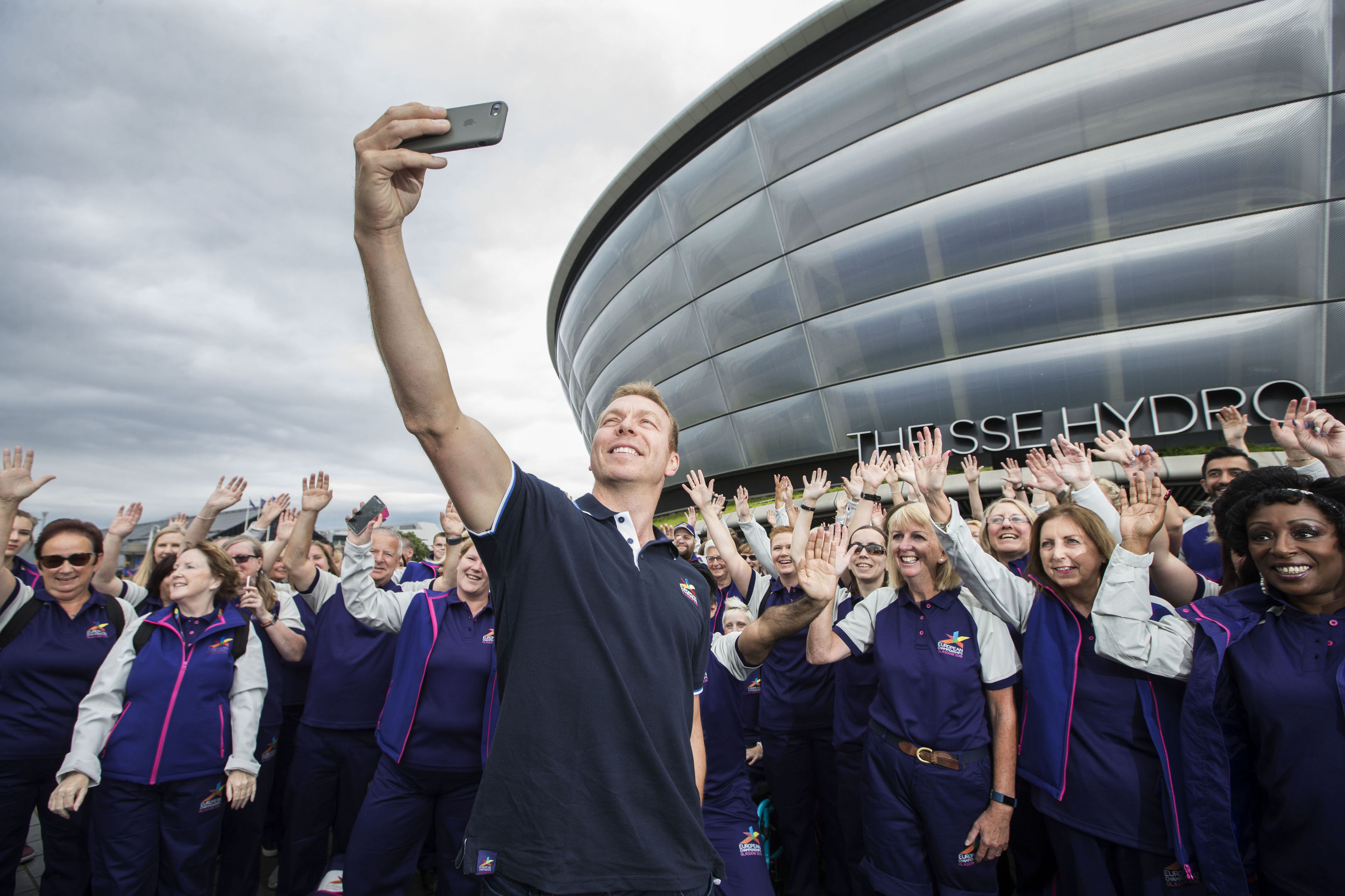 Sir Chris Hoy meets volunteers for the Glasgow 2018 European Championships outside the SSE Hydro (Colin Templeton/PA Wire)