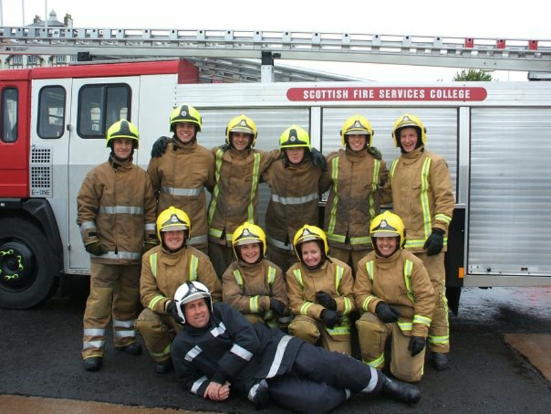 Lynn Bell, second from the right on bottom row, says being in the fire service had been her dream