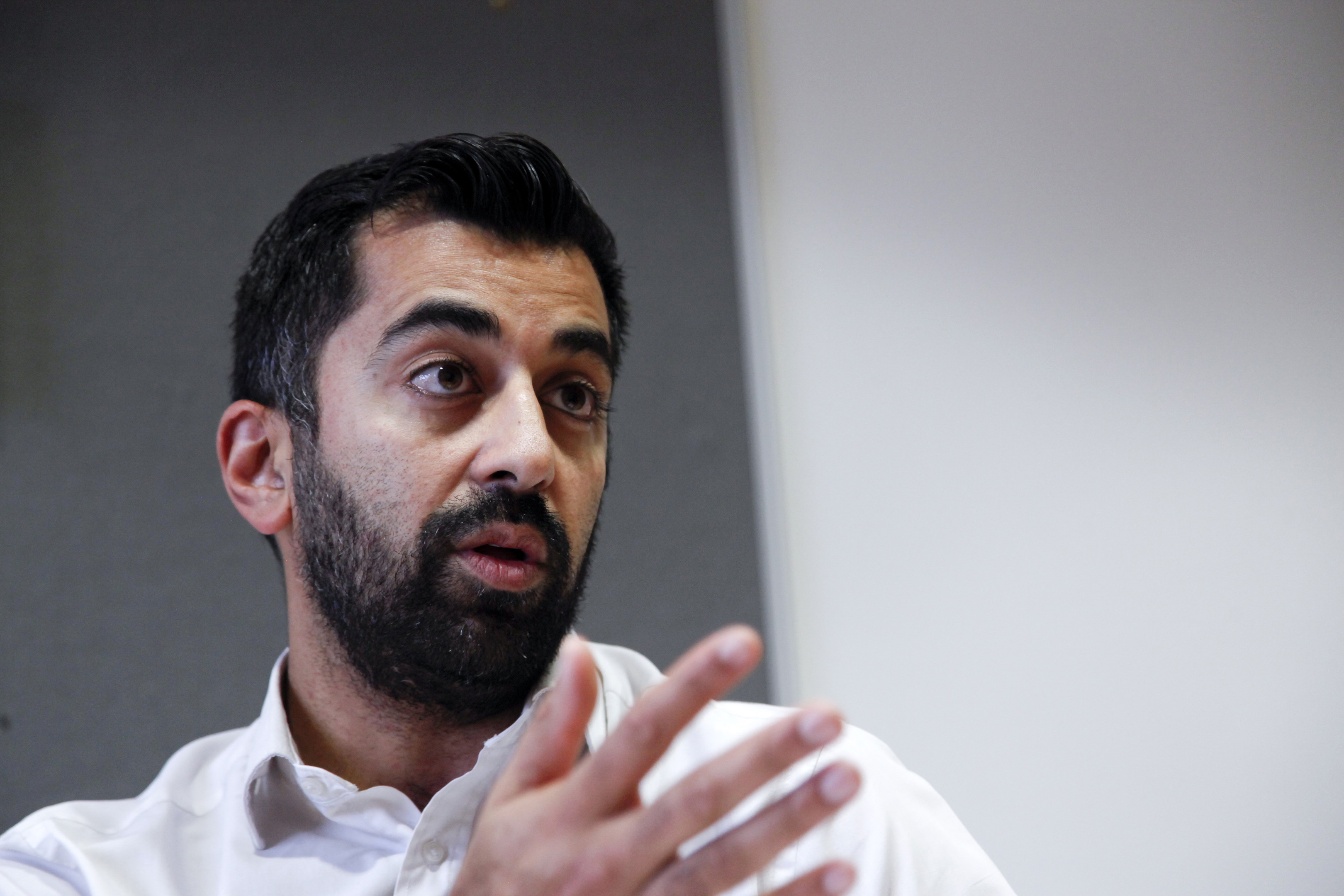 Humza Yousaf MSP being interviewed at the Scottish Parliament (Alistair Linford)