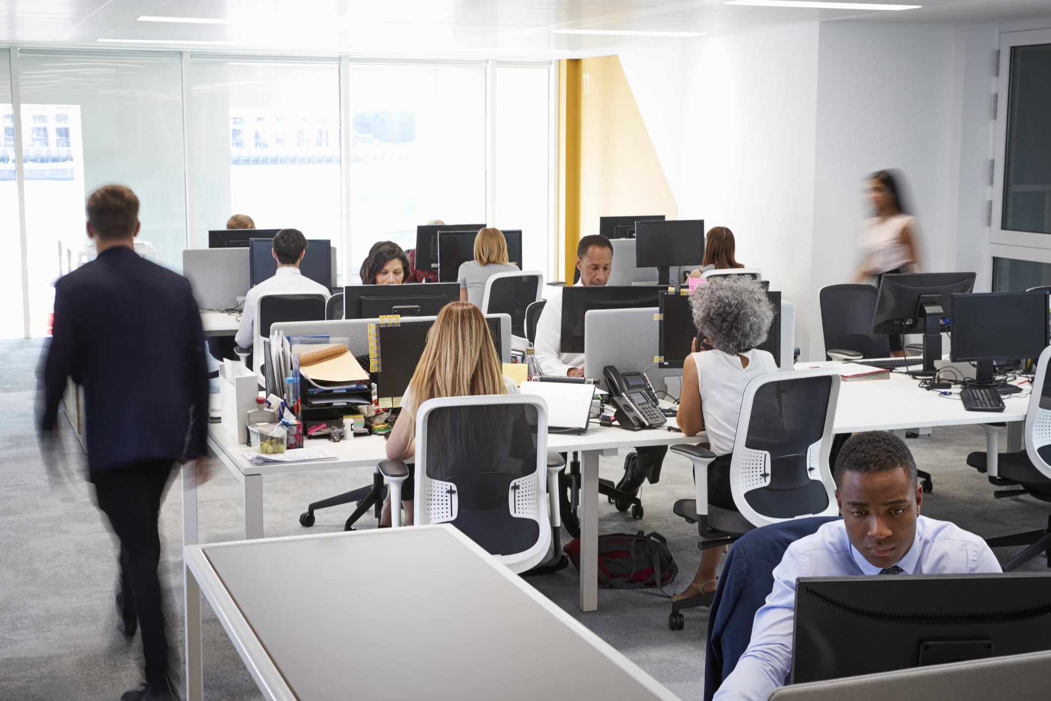 UK employees spend an average of 50 hours a week at work. (Getty Images)