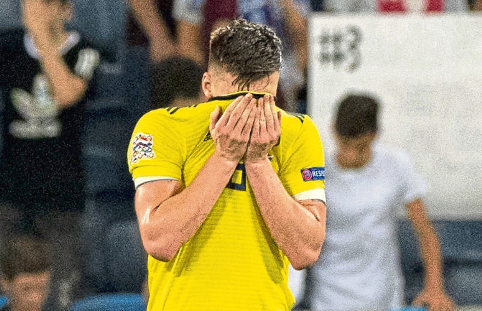Kieran Tierney looks dejected after scoring an own goal in the Israel game (SNS Group)