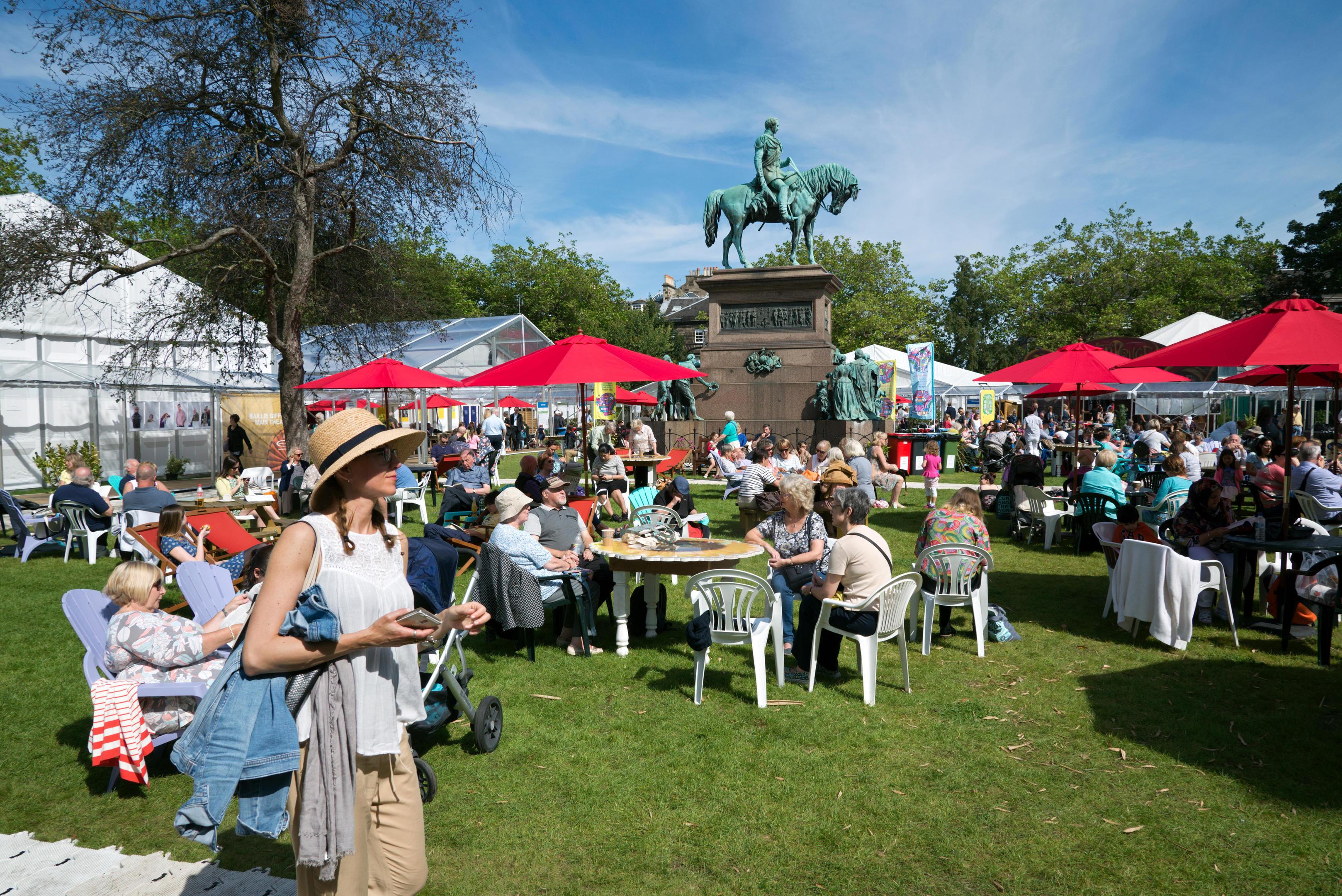 Visitors to the annual Edinburgh Book Festival enjoying the sunshine in Charlotte Square.