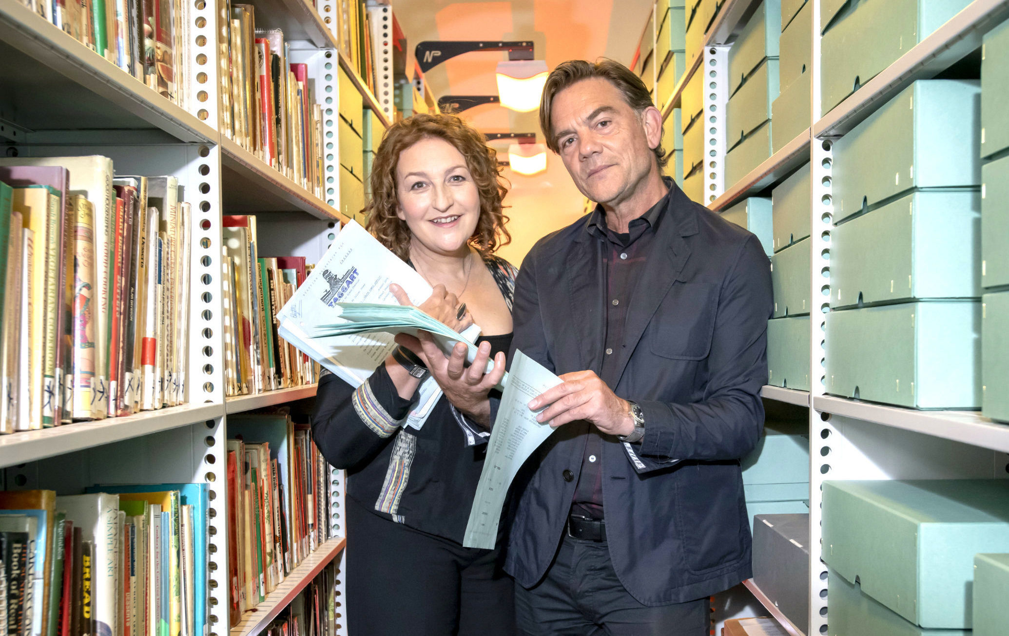 Taggart stars Blythe Duff and John Michie handing over scripts and memorabilia (Glasgow Caledonian University/PA Wire)