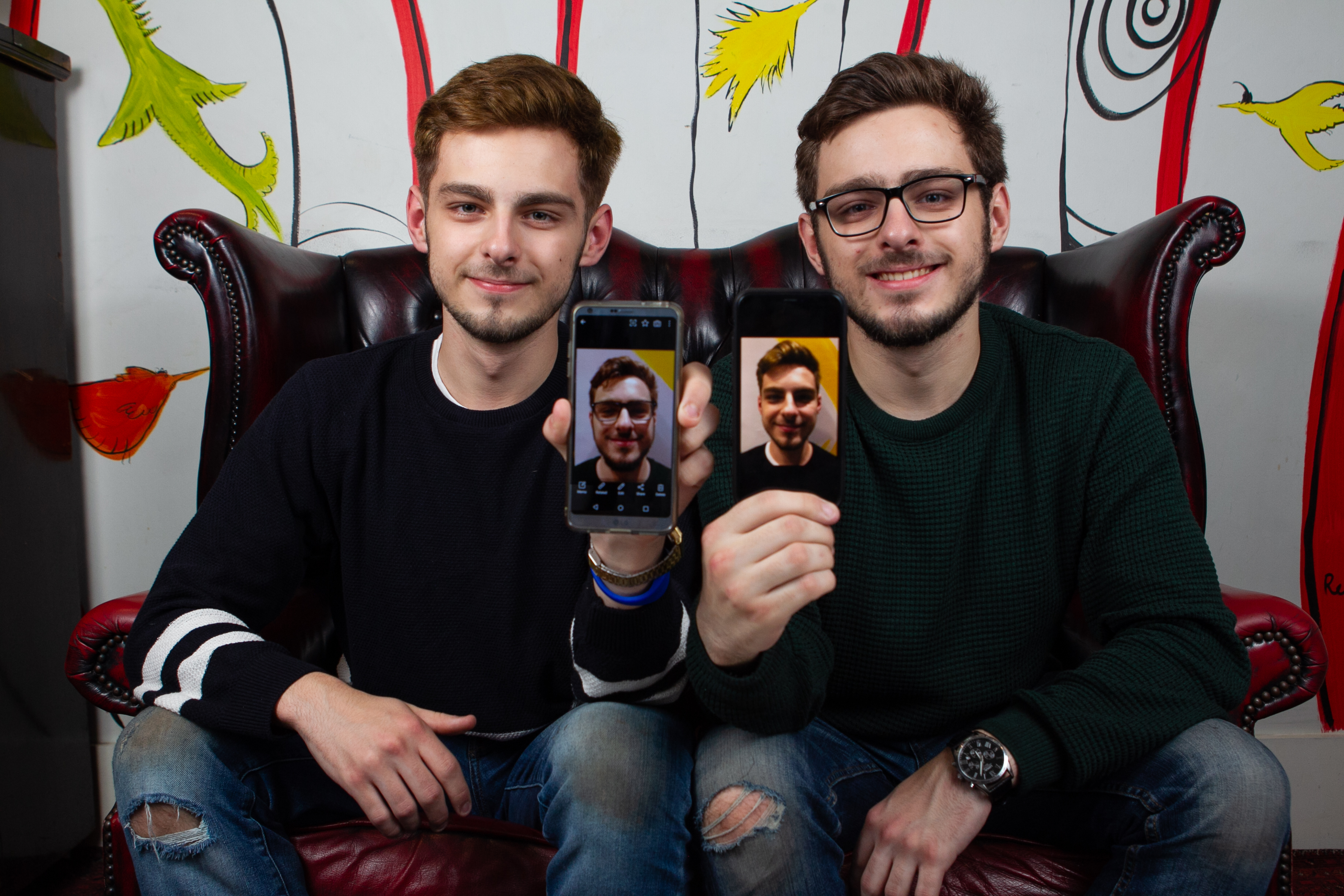 Thomas and William Johnson with their phones (Andrew Cawley / DC Thomson)
