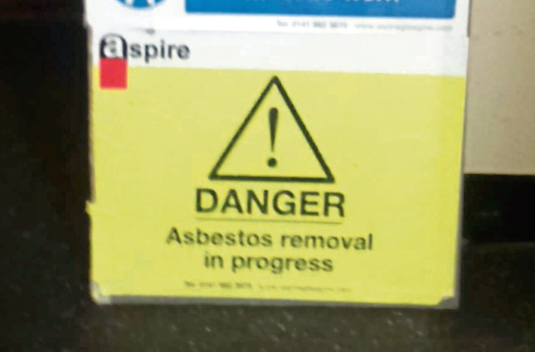 One of the warning signs outside the flats