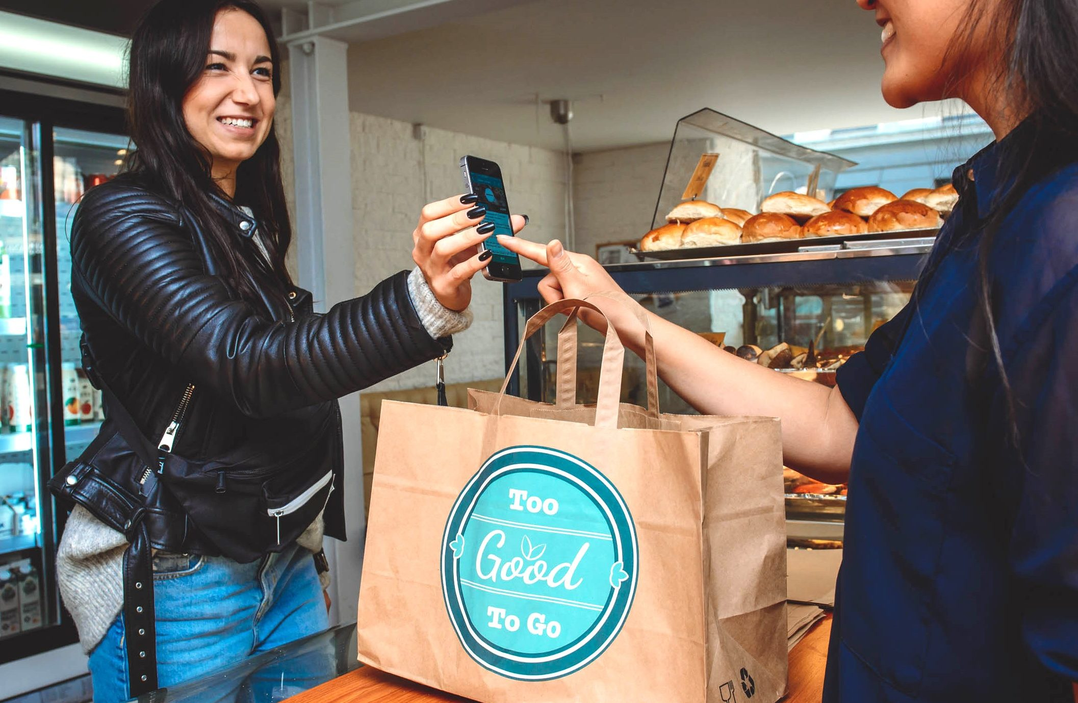 A customer saves food destined for the bin with the Too Good To Go app. (Too Good To Go)