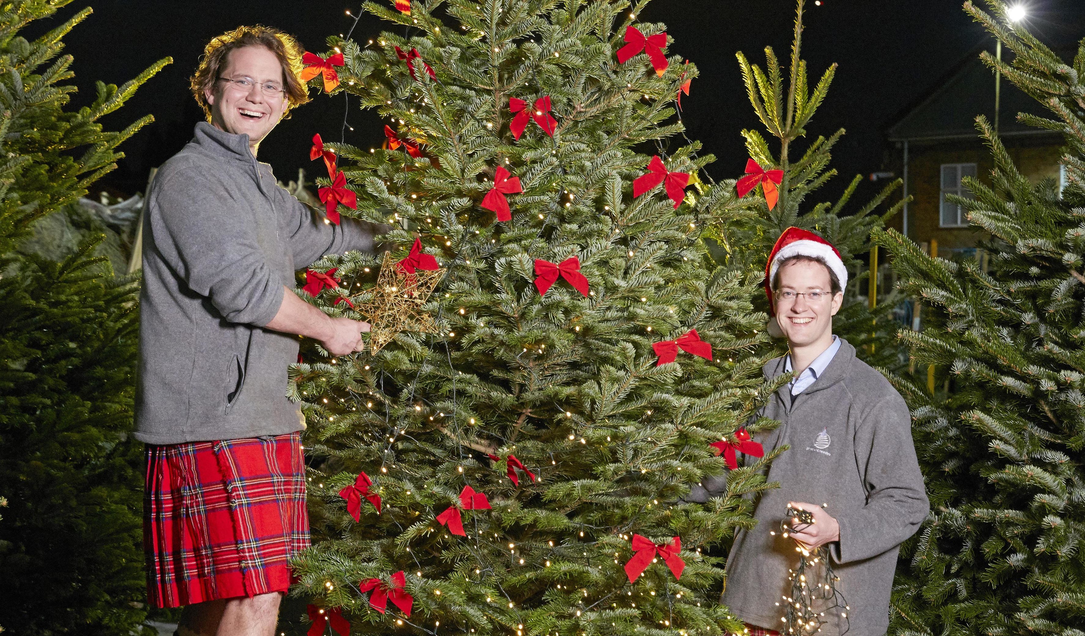 Kilted brothers Sam and Josh Lyle decorate one of their trees at Pines And Needles (Les Wilson)