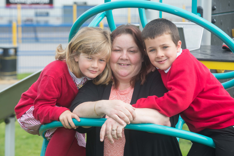 Dora Forbes from Aberdeen with her beloved grandchildren. Her husband Scott was murdered by his brother ten years ago. (Derek Ironside/Newsline Media)