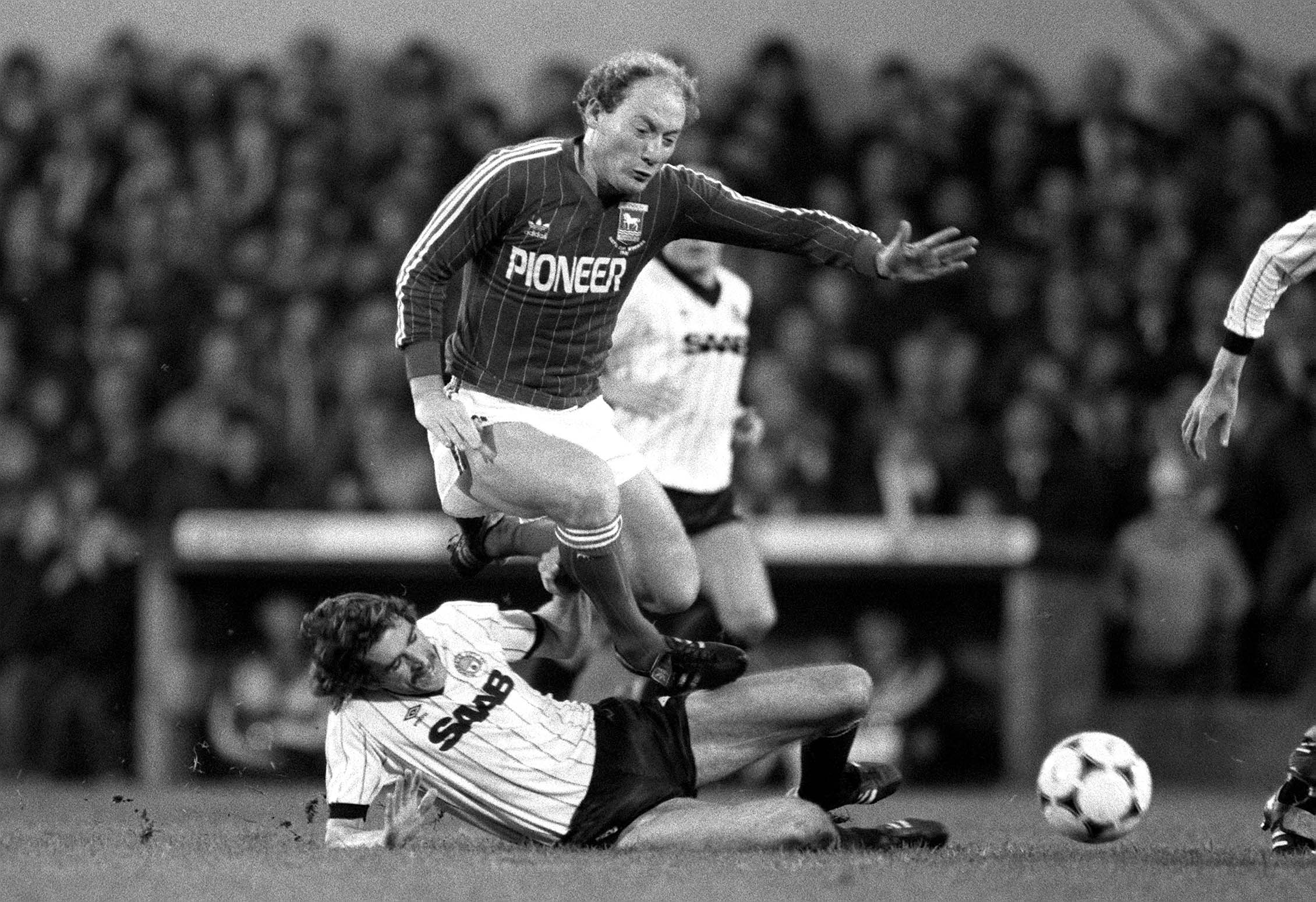 Alan Brazil feels the full force of this tackle by Manchester City's Paul Power in 1982. (Mark Leech/Getty Images)