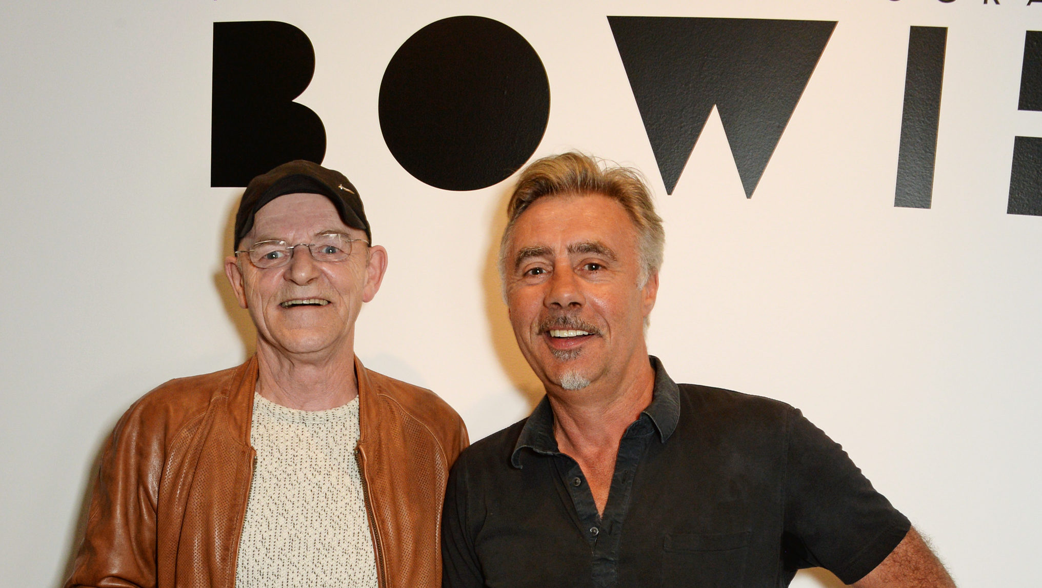 Mick Woodmansey (L) and Glen Matlock attend a private view of new exhibition 'David Bowie: Fame, Fashion, Photography' at The Hub. (David M. Benett/Dave Benett/Getty Images)