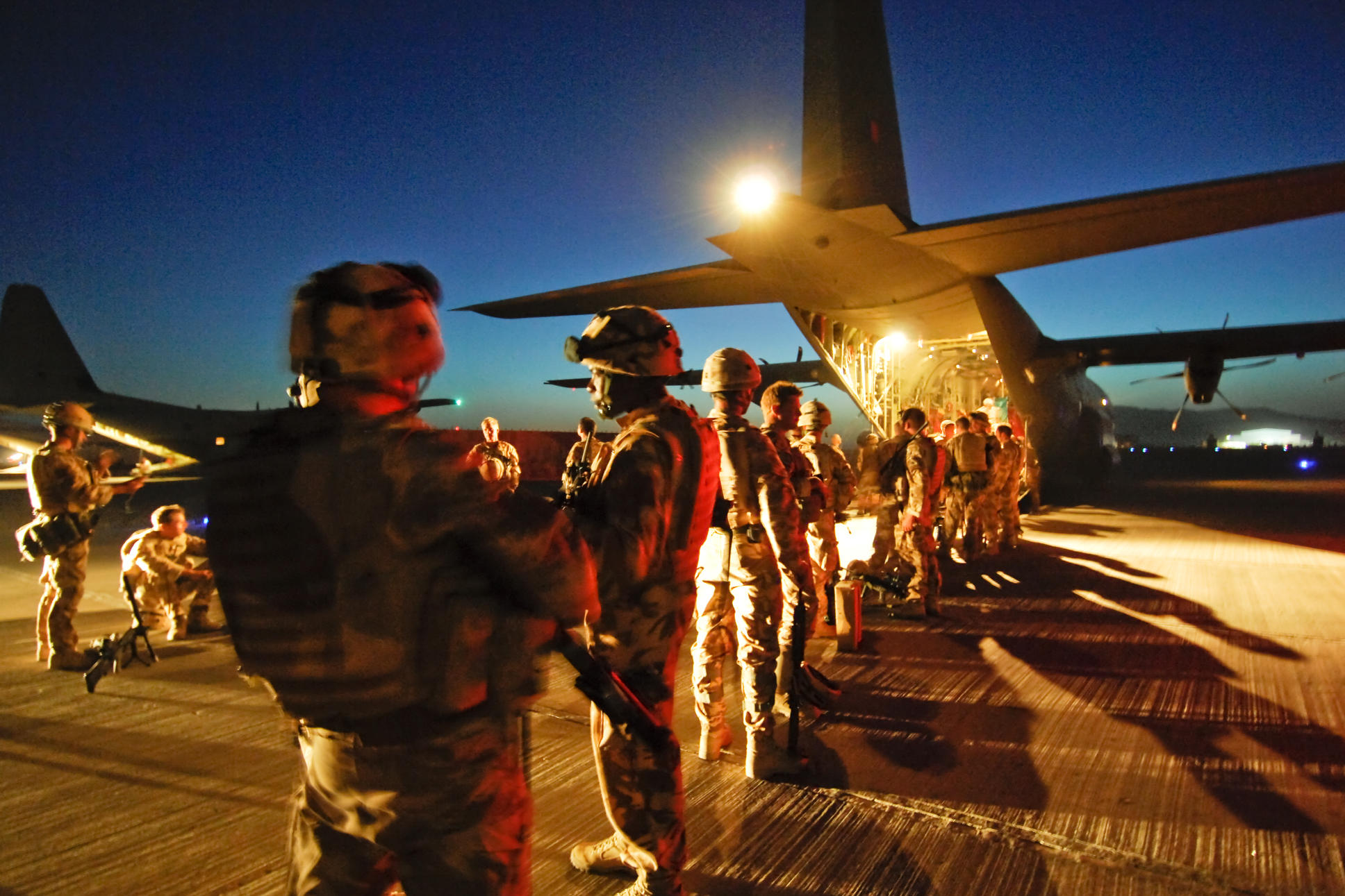 Troops from 3 Scots, The Black Watch prepare to board a Royal Air Force Hercules C130J aircraft at Kandahar Airfield, Afghanistan.