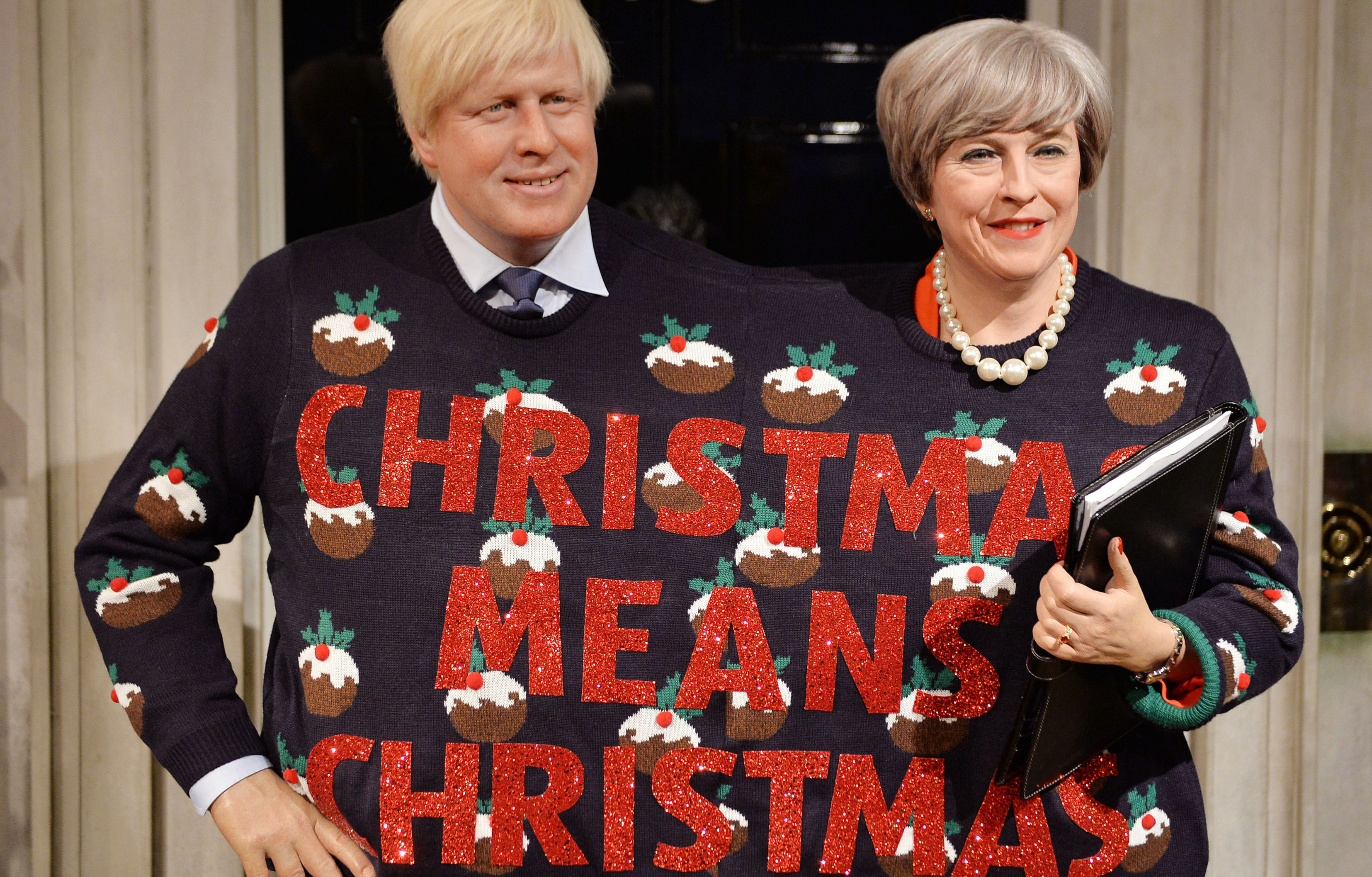 Waxwork Boris and Theresa share the Christmas spirit (John Stillwell/PA Wire)