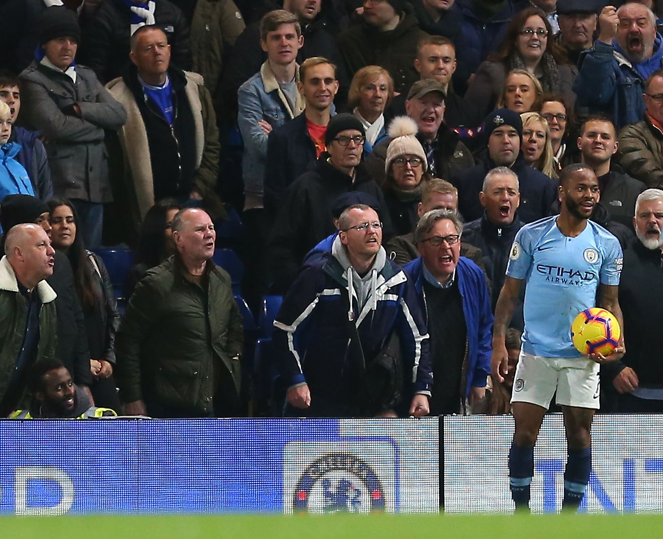 Raheem Sterling of Manchester City receives alleged abuse from Chelsea fans Chelsea v Manchester City, Premier League, Football, Stamford Bridge, London, UK. (Shutterstock)