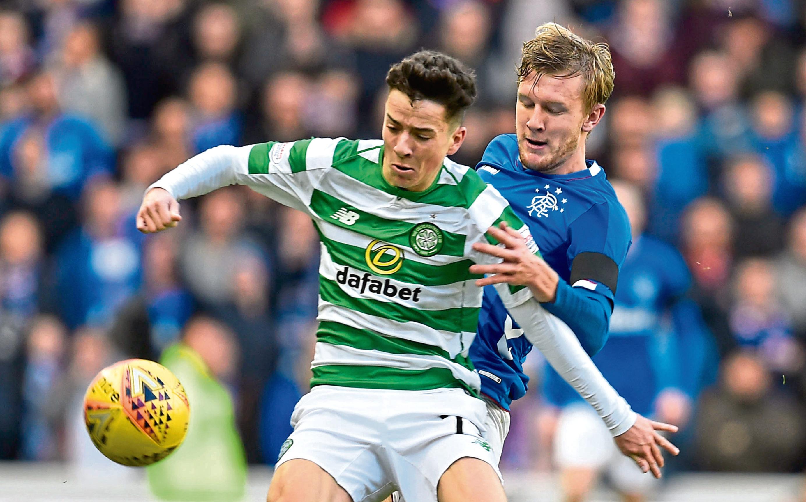 Celtic's Mikey Johnston (left) holds off Rangers' Joe Worrall (SNS Group)