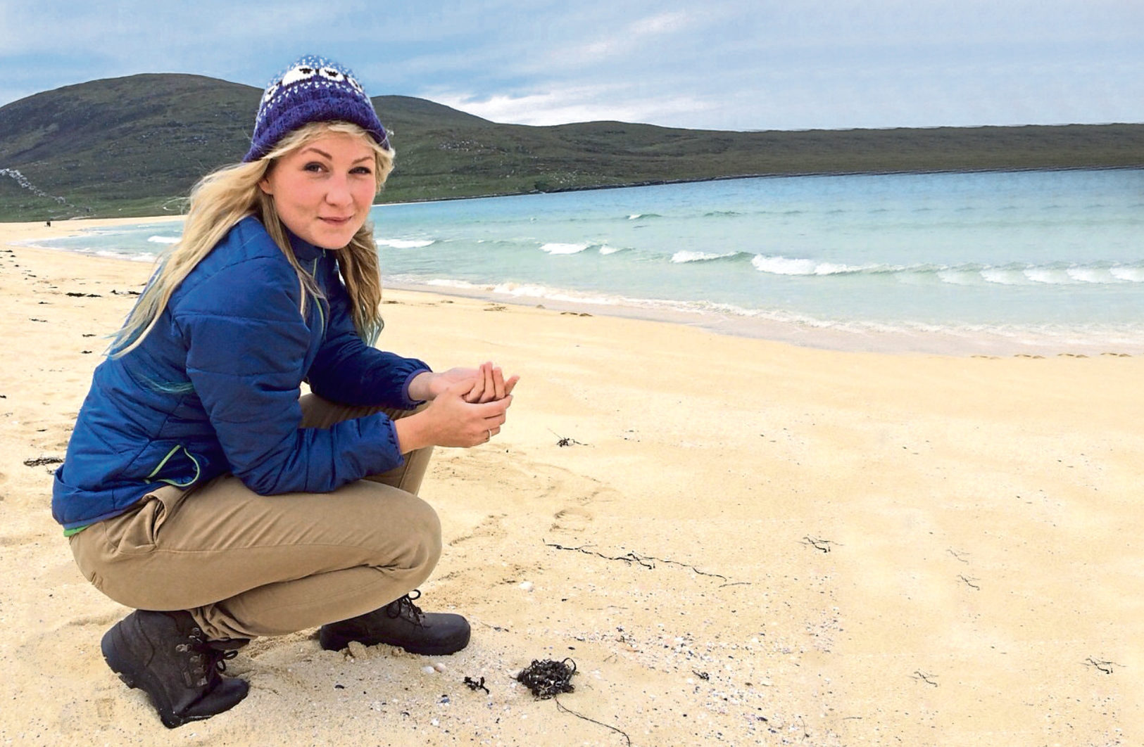 Campaigner Katie Tunn on Scarista beach, Harris, found ties from Arctic Fish plant in Donegal, Ireland