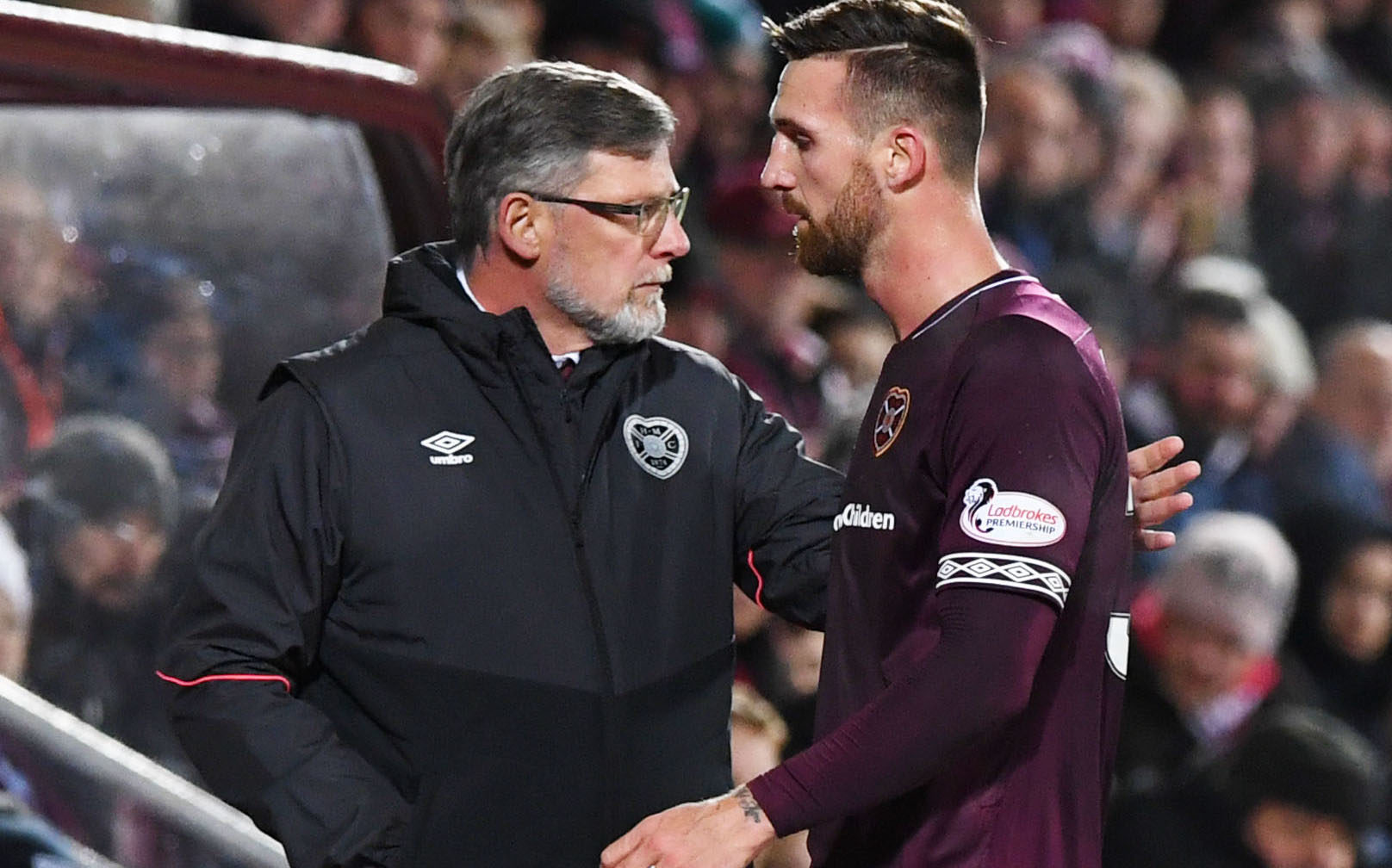 Hearts' David Vanecek walks past manager Craig Levein after being substituted in the first half (SNS Group)