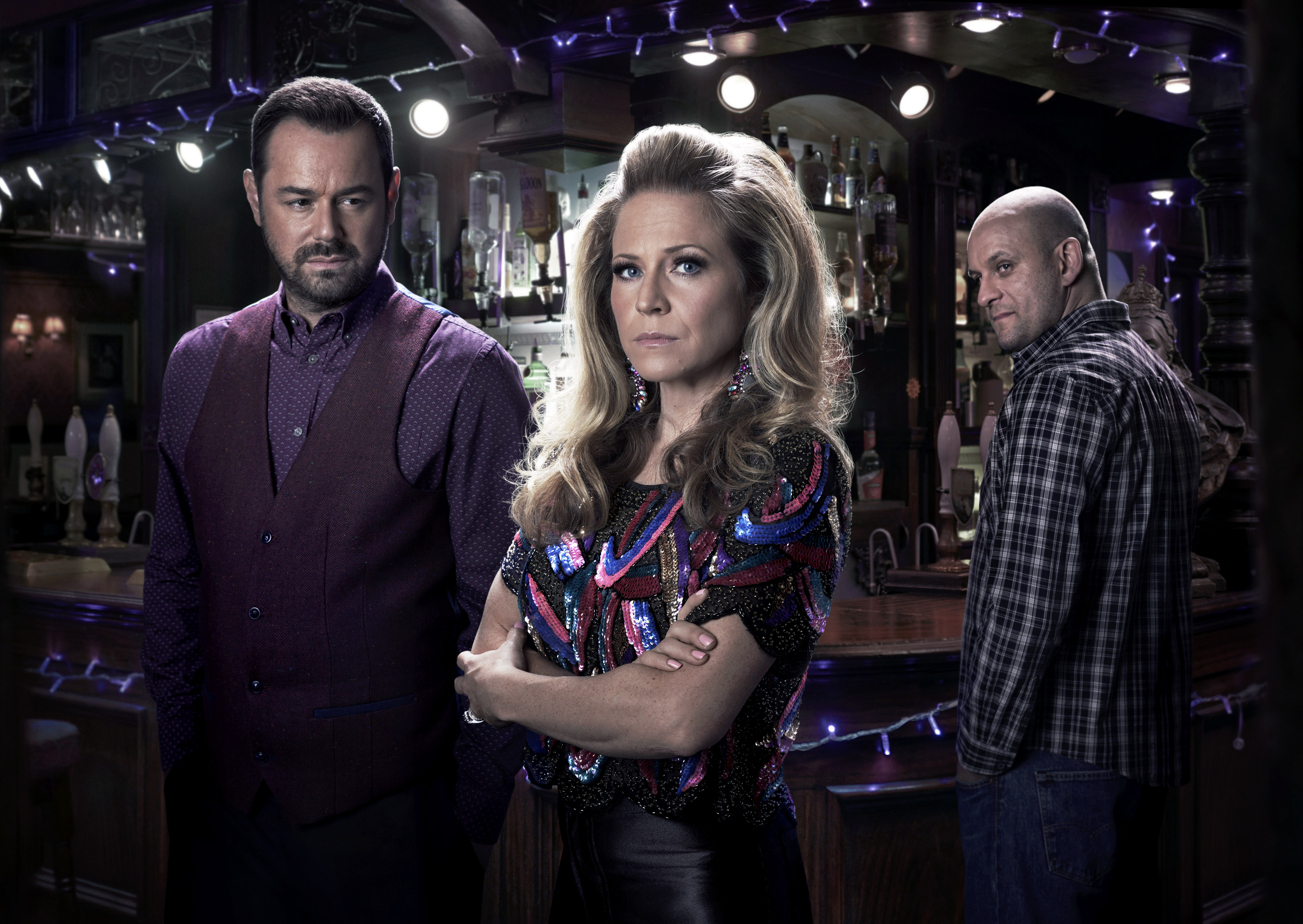 Ricky Champ, right, keeps an eye on Danny Dyer's Mick and Kellie Bright as Linda in EastEnders (BBC /Kieron McCarron)