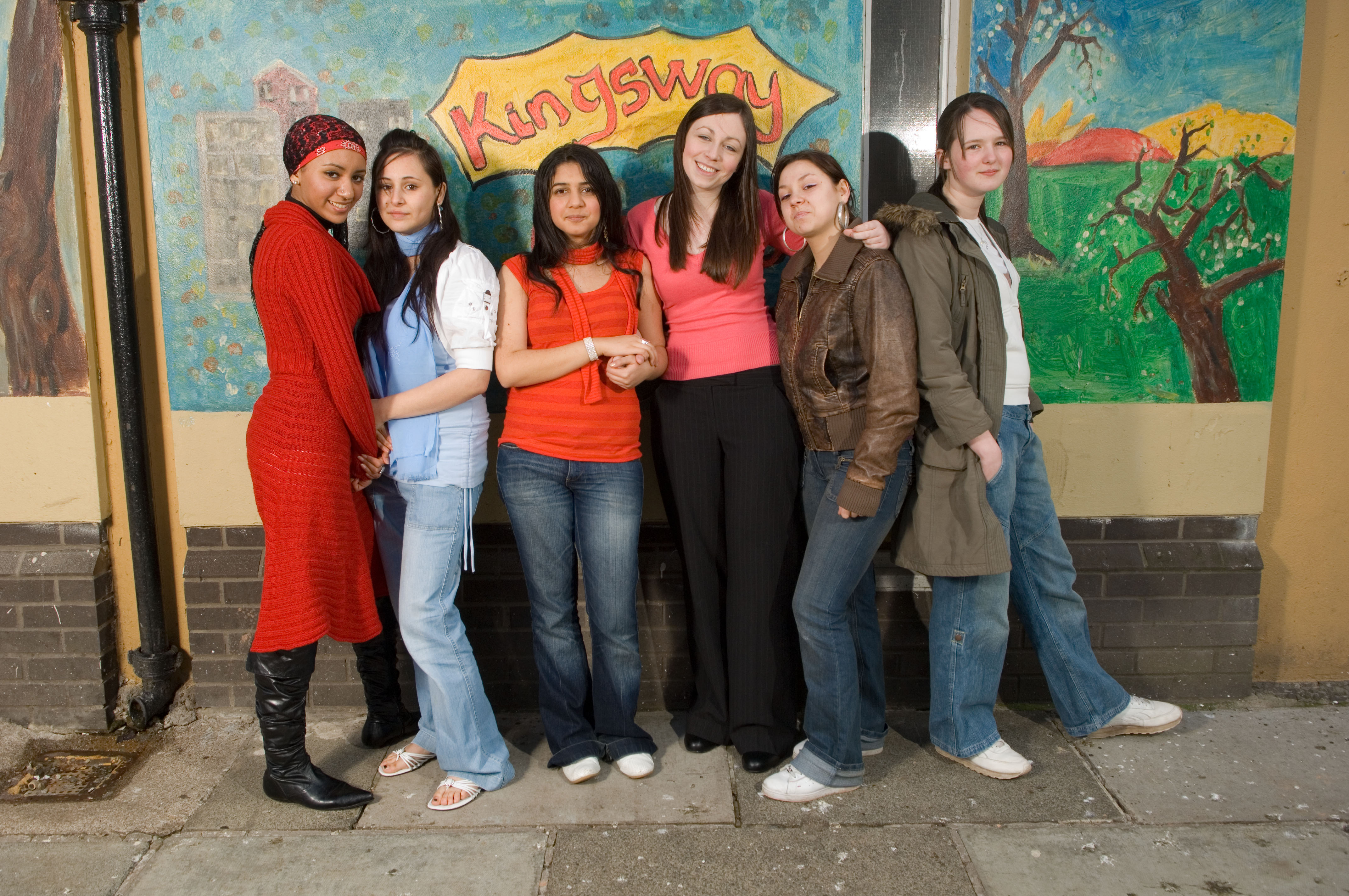 The Glasgow Girls. These girls campaign for the rights of asylum seekers in Glasgow.  Roza Salih (dark hair/red top) , Emma Clifford (Pink top) , Ewelina Siwak ( leather jacket) , Jennifer McCarron ( green parka) , Agnesa Murselaj ( blue scarf ) , Amal Azzudin (red dress). (Wattie Cheung).