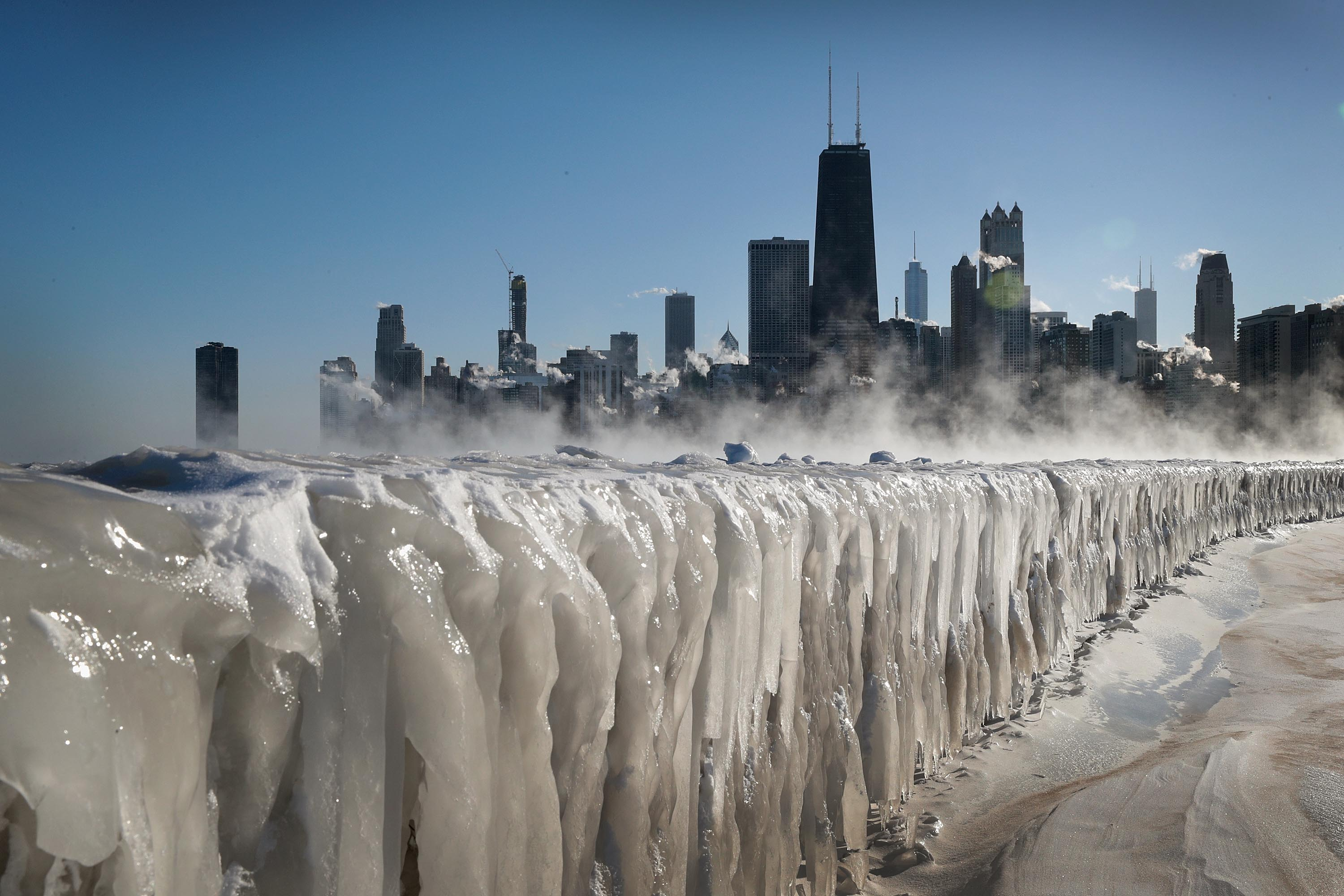 Ice covers the Lake Michigan shorelinein Chicago, Illinois. Businesses and schools have closed, Amtrak has suspended service into the city, more than a thousand flights have been cancelled and mail delivery has been suspended as the city copes with record-setting low temperatures. (Scott Olson/Getty Images)