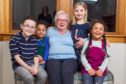 Maggie Clayton with her grandkids that she likes to give sweets and juice.
