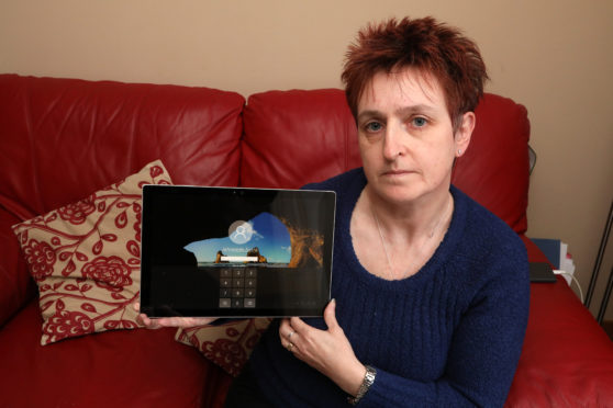 Angela Kingston with the tablet that was sold (and returned) via eBay