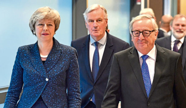 European Commission President Jean-Claude Juncker, British Prime Minister Theresa May and European Union chief Brexit negotiator Michel Barnier