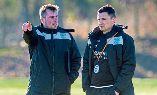 Hibernian manager Paul Heckingbottom (R) with assistant Robbie Stockdale