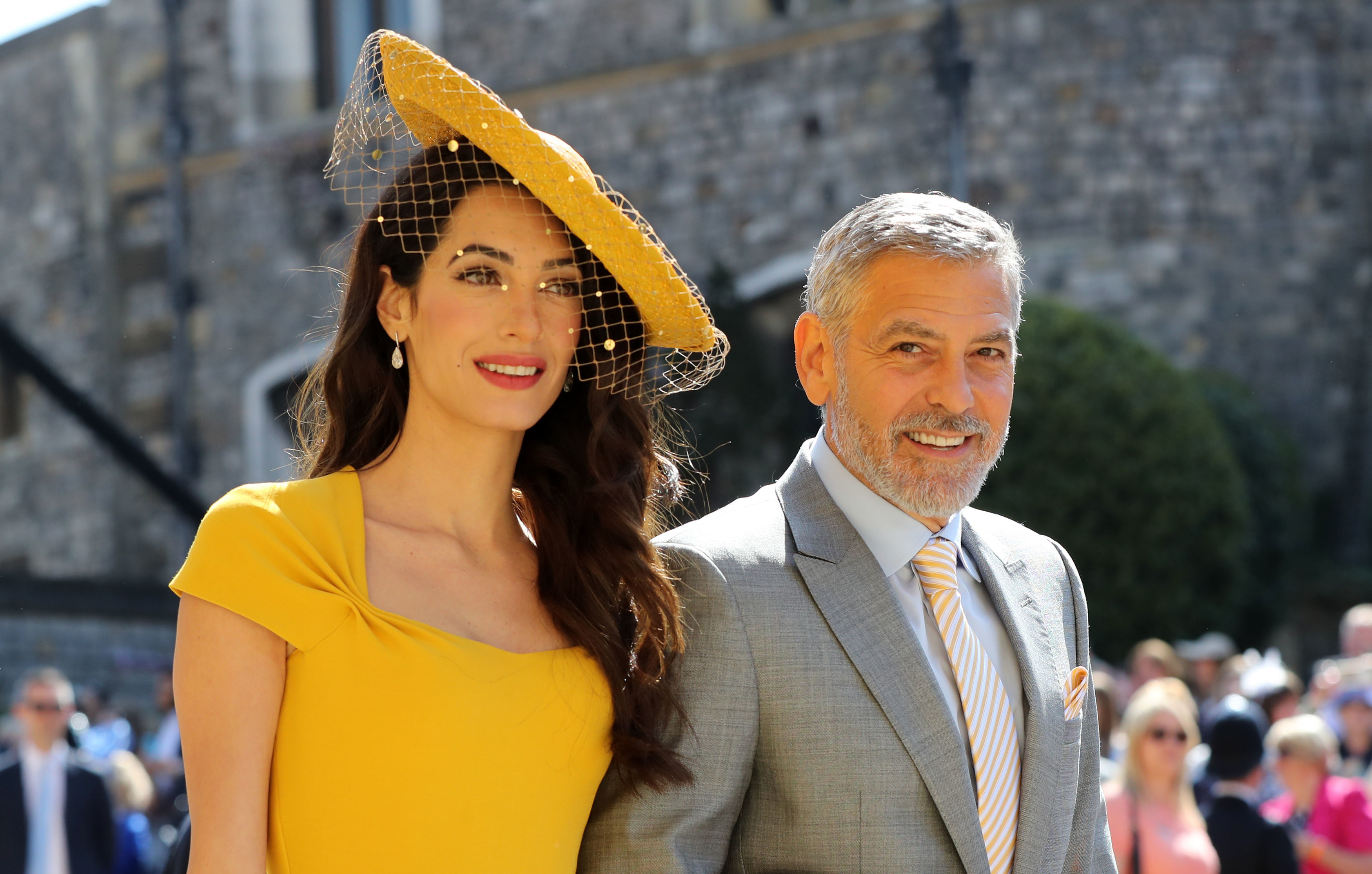 Amal Clooney and George Clooney arrive attending the wedding of Meghan Markle and Prince Harry (Gareth Fuller/PA Wire)