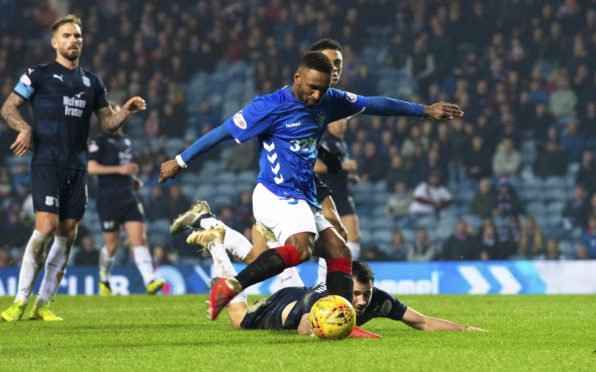 Jermain Defoe scores an emphatic fourth goal against Dundee