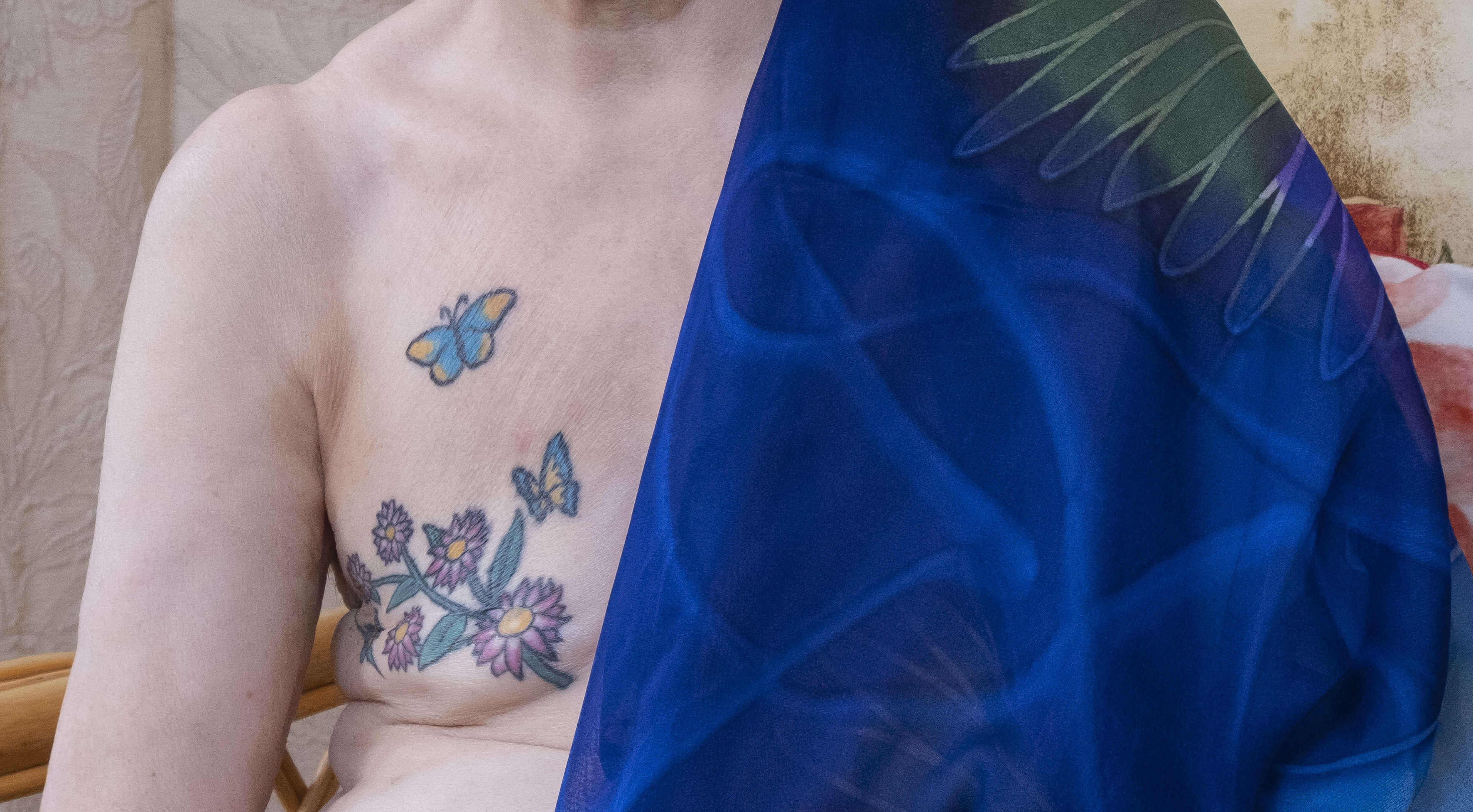 Liz Howley's tattoo over her mastectomy scar. (Tina Norris).