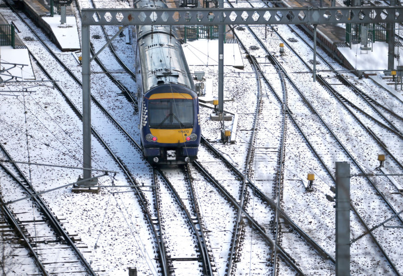One of the few trains running leaves Edinburgh Waverley