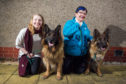 Aine Bidgood, left, and gran Doreen with German Shepherds Oscar and Kai