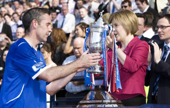 Davie Weir receives the Scottish Cup in 2009 from Nicola Sturgeon, then the Deputy First Minister