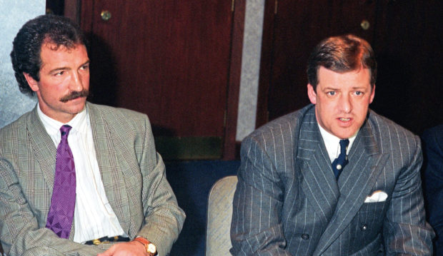 Rangers chairman David Murray (right) gives details of Graeme Souness' departure from the club in 1990