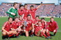 Willie Miller (centre) after Aberdeen's Scottish Cup win in 1986