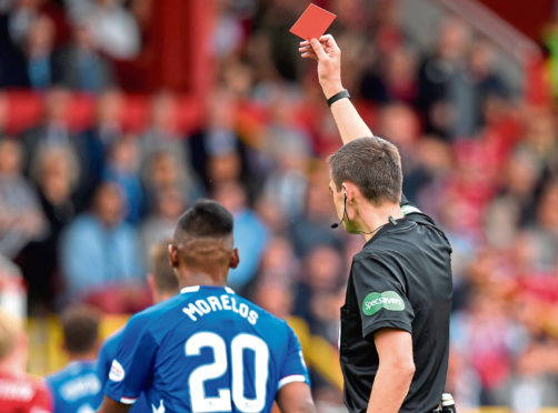 Rangers' Alfredo Morelos is shown a red card by Kevin Clancy in August's league match against Aberdeen