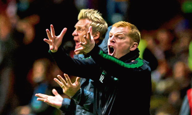 Celtic manager Neil Lennon (right) and assistant Johan Mjallby urge their team on from the sidelines, 2013