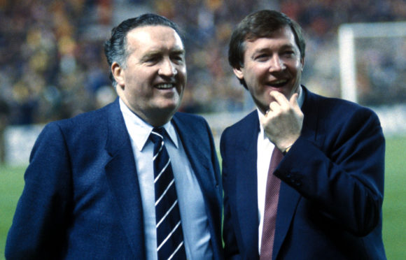 Jock Stein and Alex Ferguson, seen together in 1985, are both in the top 50 of a new list of top managers
