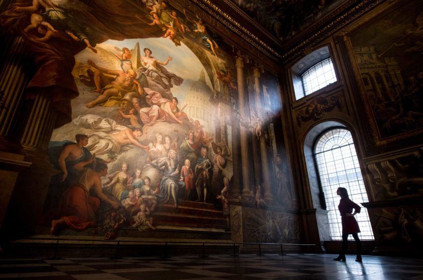 A visitor views Greenwich's Painted Hall at the Old Royal Naval College in London, following a two-year National Lottery funded conservation project