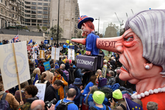 Tens of thousands of people march to demand a People's Vote and a second referendum vote on Brexit