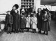 A family of twelve from the Hebrides on the deck of the Marlock, enroute to Canada.