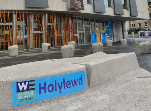 Women's Equality Party brand Scottish Parliament with 'Holylewd' signage