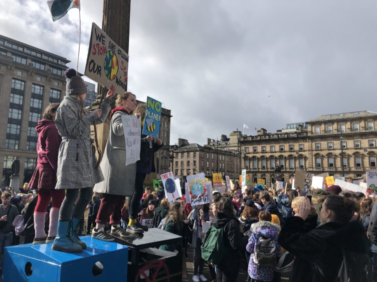 The demonstrators were undeterred by the changeable weather