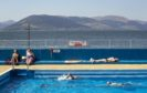 Swimmers and sunbathers enjoy the hot weather at Gourock Outdoor Pool, a heated salt water lido in Gourock, Renfrewshire.