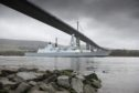 HMS Defender, a Royal Navy Type 45 Destroyer built in Clyde shipyard in 2013, passes under the Erskine Bridge on her return to Glasgow. The ship is berthed at King George V Dock, around a mile away from where it was built and launched, and is open to visitors all weekend