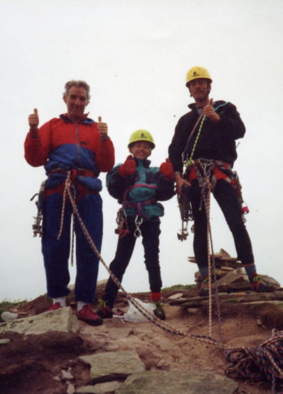 Leo, centre, dad Mark, right, and Ken Tilford summiting the Old Man of Hoy in 1991