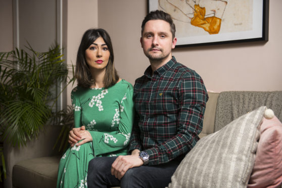 Natasha Radmehr and her boyfriend Jamie Flynn at their home in Glasgow.